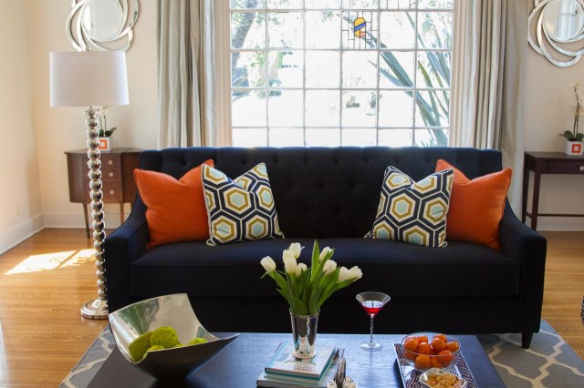 Contemporary Living Room With Navy Sofa And Colorful