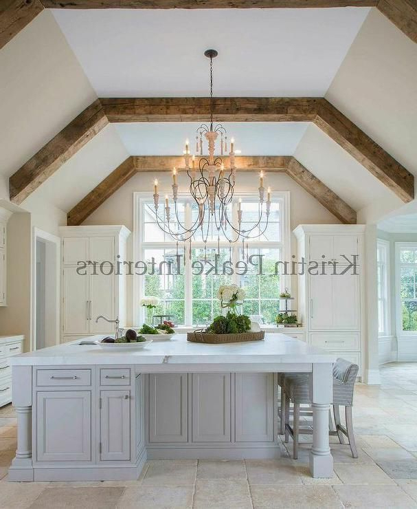 Elegant Kitchen With Vaulted Ceilings Lined With Rustic