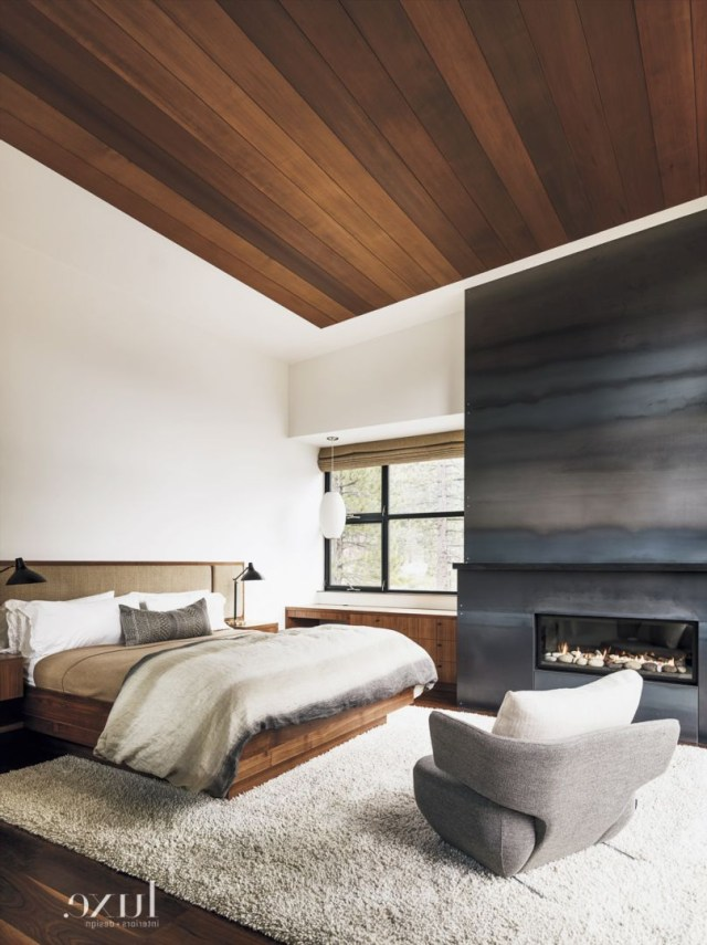 Masculine Master Bedroom With Wood Ceiling And Sleek