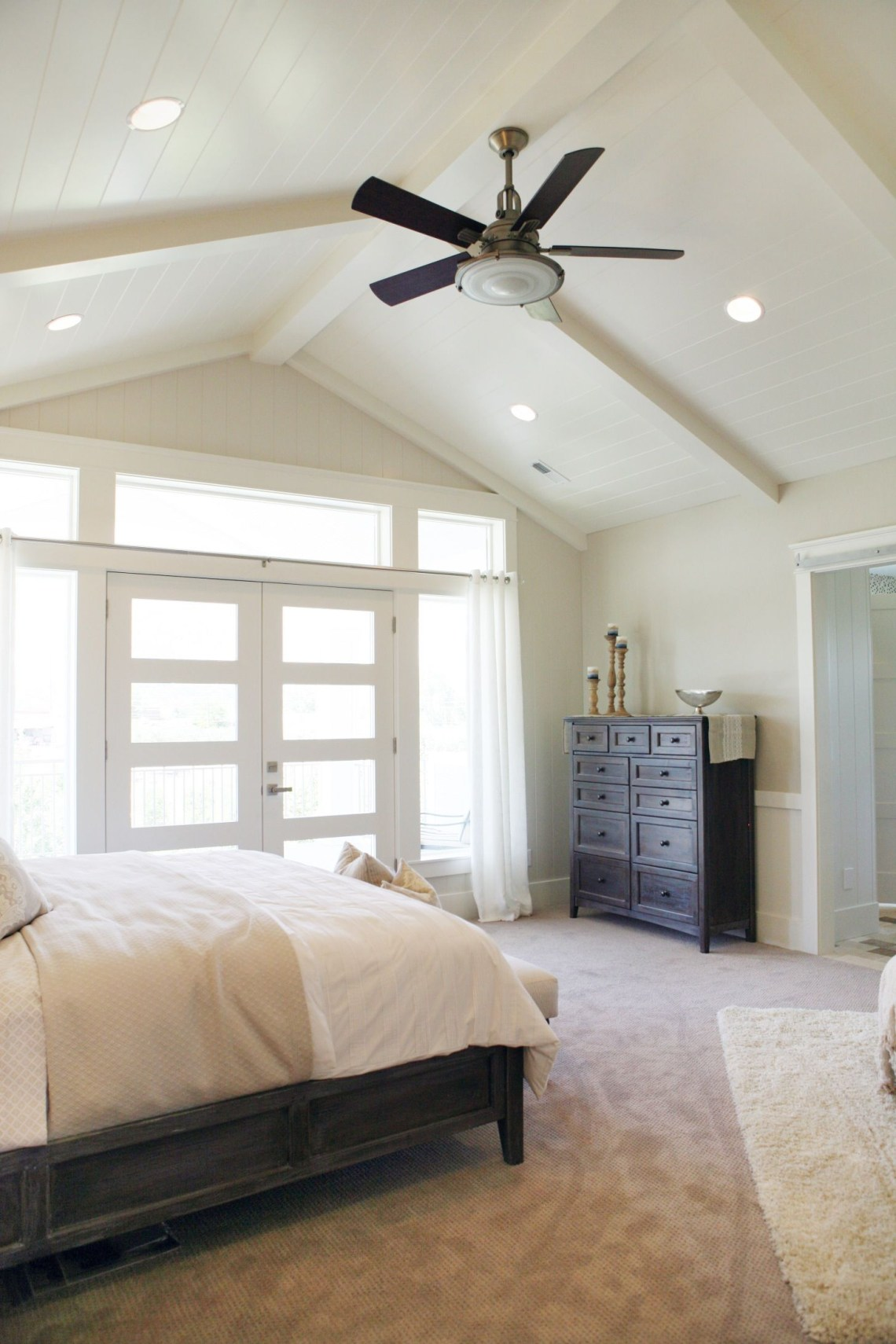 Master Bedroom High Ceiling Bright Windows And A Fan