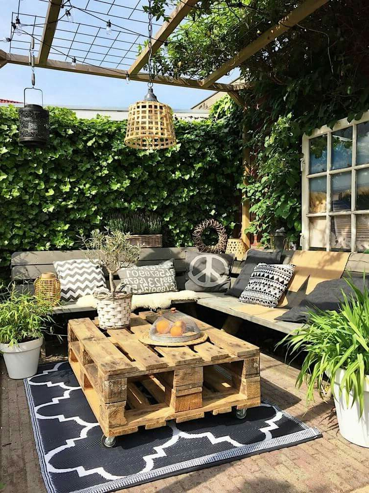 Roof Top Seating Area Surrounded A Wall Of Green And