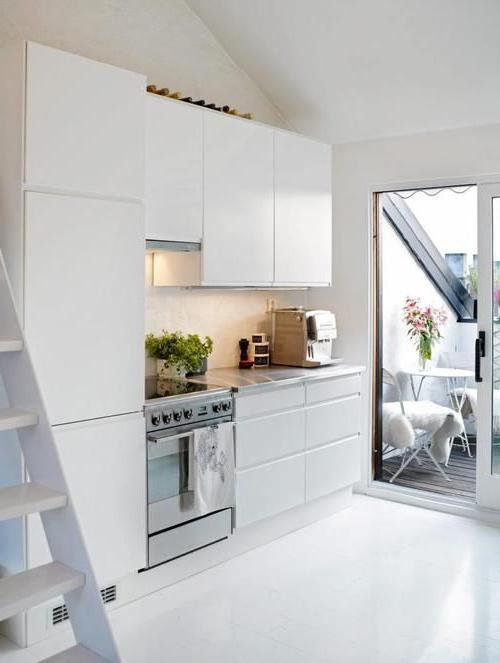 Small Minimalist Open Space Kitchen In Living Room Corner