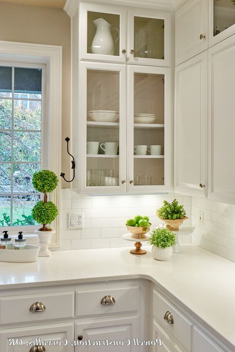 This Classic White Kitchen With Fresh Accents And Open Glass Louvered Cabinets And Sub