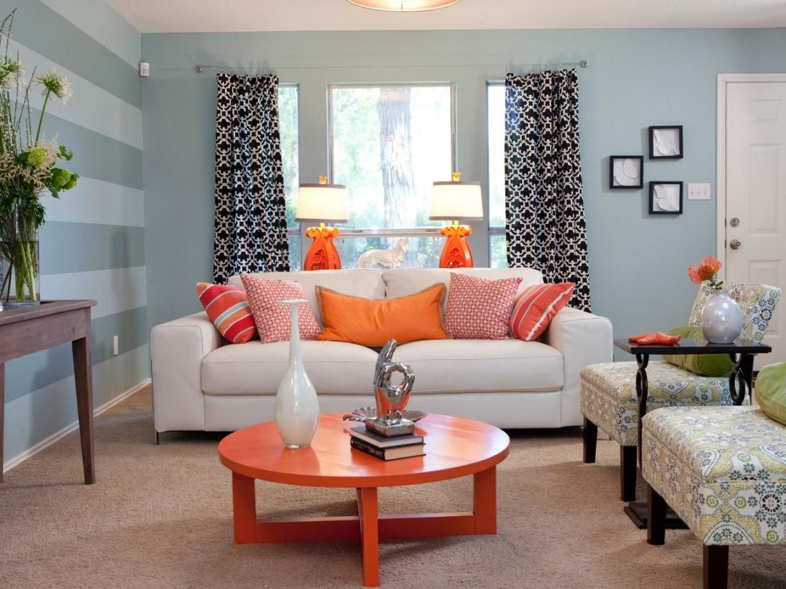 Top 25 Amazing Makeovers From Jonathan And Drew Scott Living Room Orange Striped Walls Living