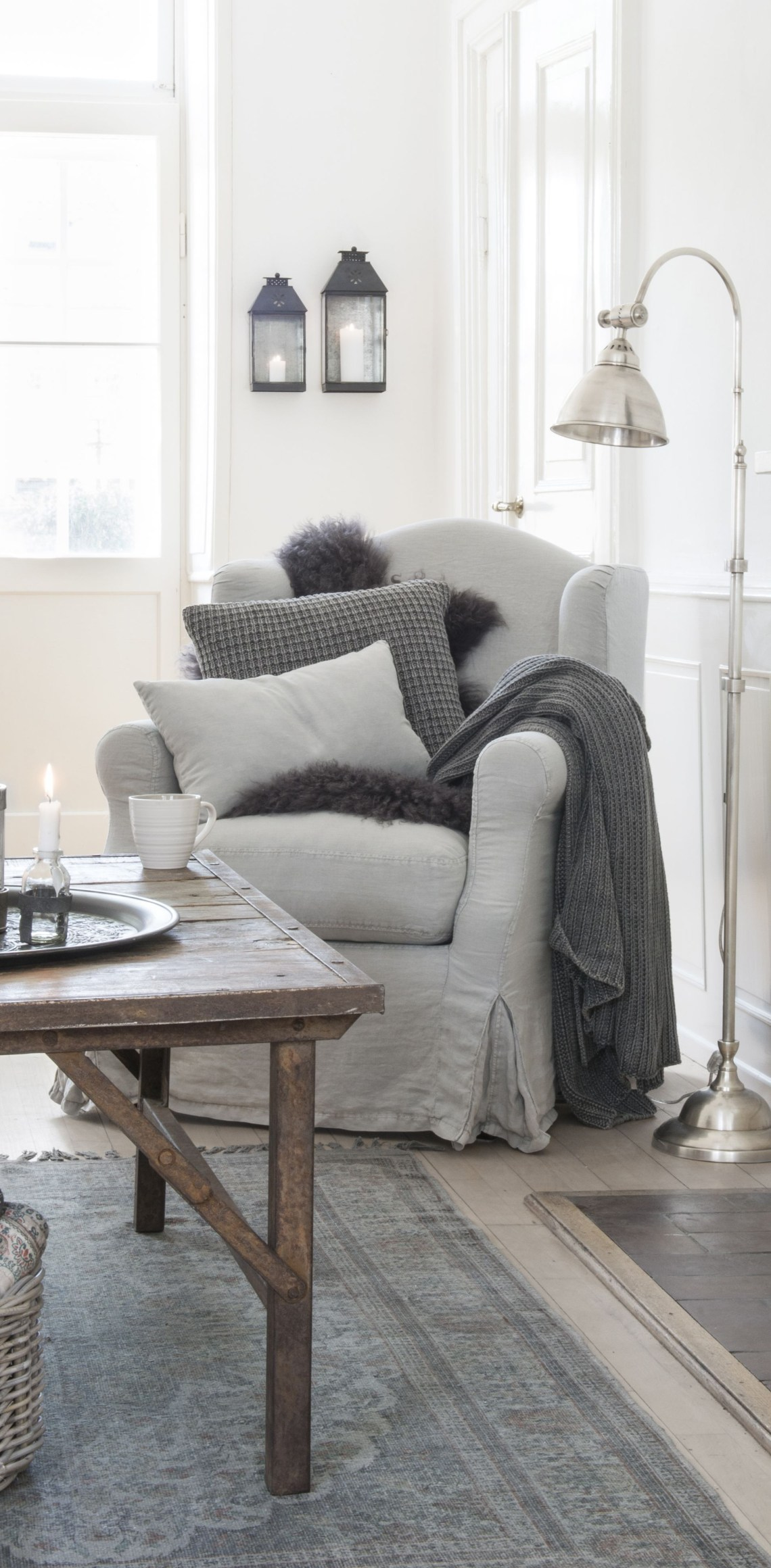 White Sitting Room With Gray Furniture Throw Blankets