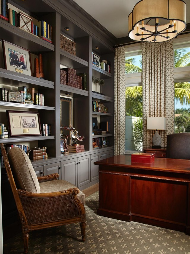 With A Glossy Mahogany Desk And Expansive Gray Built Ins