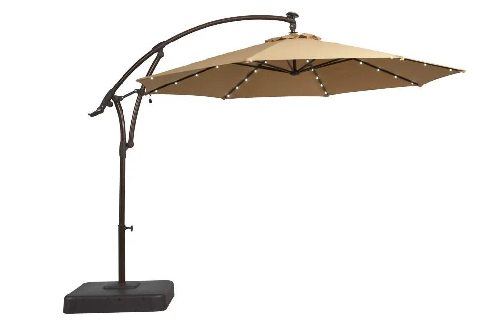 11 ft solar offset patio umbrella in cafe