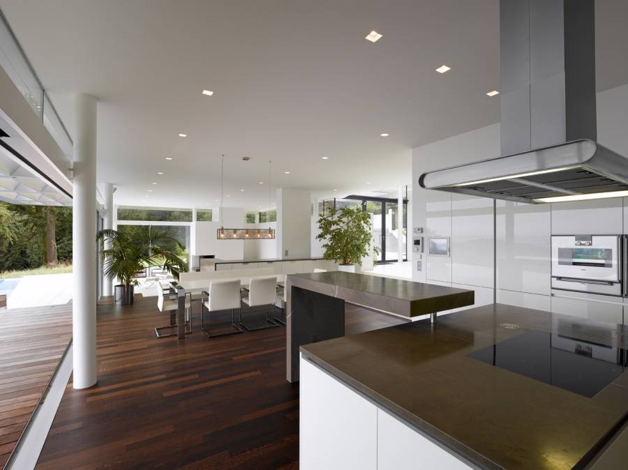 Contemporary Kitchen With Hardwood Floors Open To Dining