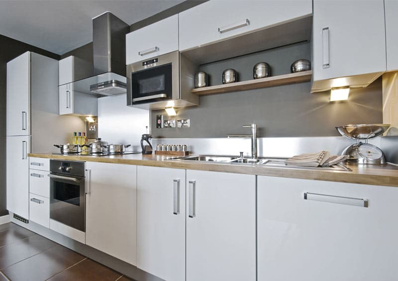 Kitchen lore states that the ideal width of a galley kitchen aisle is approximately 4 to 6 feet—but whether your small galley kitchen is dead on with that measurement or even smaller, you can create a more efficient space and also add design features that can expand the area visually. The 5 Most Popular Kitchen Layouts - Home Dreamy