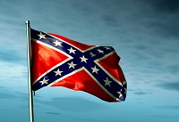 Confederate flag waving in the dark evening