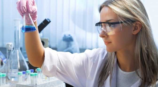 Student in lab using science curriculum