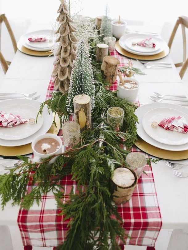 A Bright Winter Table With A Red Plaid Runner, Napkins, Birch Branches, Faux Christmas Trees And An Evergreen Runner