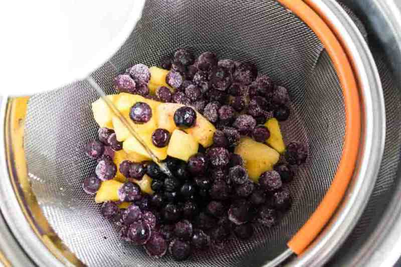 Instant Pot Pineapple Blueberry Fruit Infused Water Recipe- Making Fruit Infused Water in your Instant Pot has never been easier! The combination of pineapple and blueberry is incredible and refreshing. #infusedwater #instantpot #pressurecooker #blueberry #pineapple #easy #best #delicious #homefreshideas