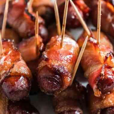 "Learn How To Make Air Fryer Bacon Wrapped Smokies - Air Fryer Bacon Wrapped Smokies are a game-changer! They are much easier than in the oven and will ""WOW"" your party guests. Try them and see for yourself. #bacon #wrappedsmokies #appetizer #partyfood #easy #homefreshideas"