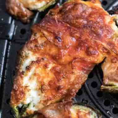The Best Air Fryer Bacon Wrapped Jalapeno Poppers Recipe - Serve these Air Fryer Bacon Wrapped Jalapeno Poppers next time you are hosting a party or sitting around watching the big game. Your guests will devour them! #jalapenopoppers #appetizers #easy #recipe #airfryer #homefreshideas