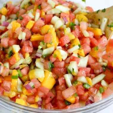 bowl of watermelon salsa with spoon in it