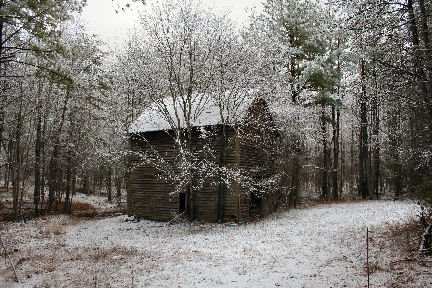 snow on old tobacco barn