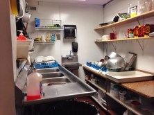 Like the storeroom, Kathy diligently keeps the kitchen sparkling.