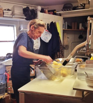 Kathy peels and shreds potatoes for hash browns. She too was born and raised in South Bend and has worked as Jeannie's primary dishwasher and food prep assistant since 2011.