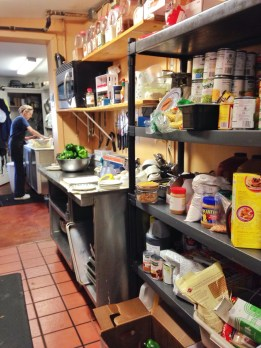 """Kathy's storeroom is always impeccably organized, with ingredients neatly shelved and labeled. Before coming to work at Jeannie's, Kathy worked in the kitchens of various South Bend eateries, among other odd jobs, """"I've bounced around quite a bit in the past. Now I'm here to stay."""""""