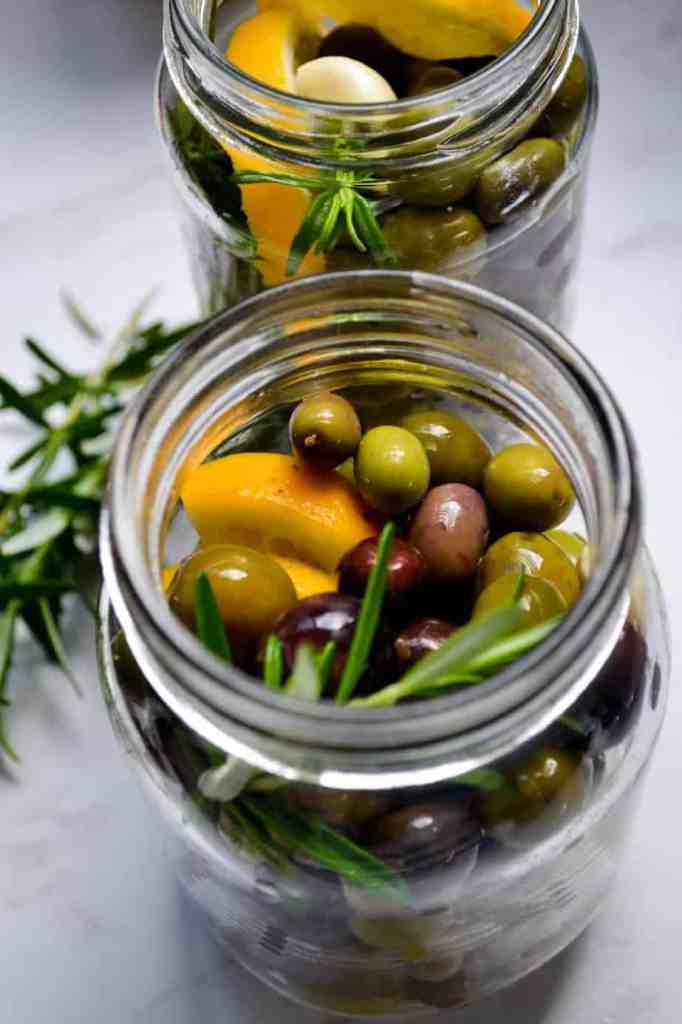 Salt brine cured olives with lemon and rosemary