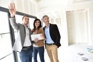 55299248 - couple with realtor visiting house under construction