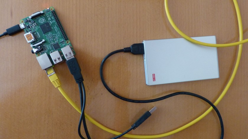 Raspberry Pi 2 with a USB-harddrive connected to my network with a (yellow) ethernet cable.