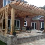 custom-pergola-with stone-porch-by-www.improvementingreenvillesc.com