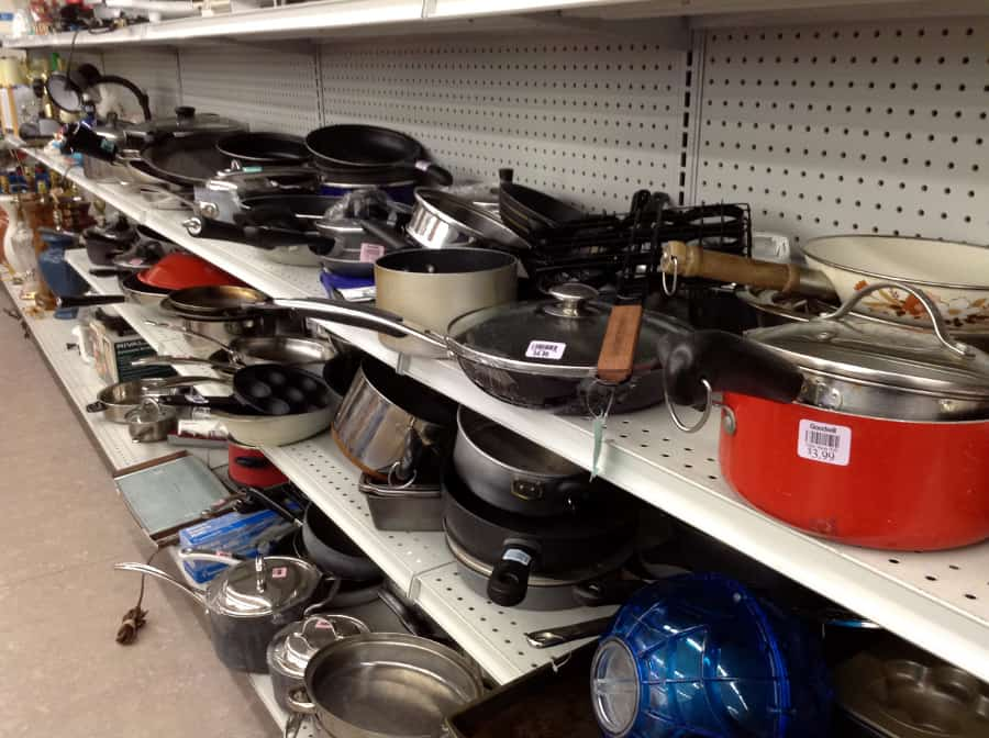 shelves full of Pots and Pans at a thrift store