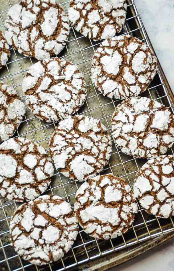 Chocolate Crinkle Cookies on a wire cooling rack.