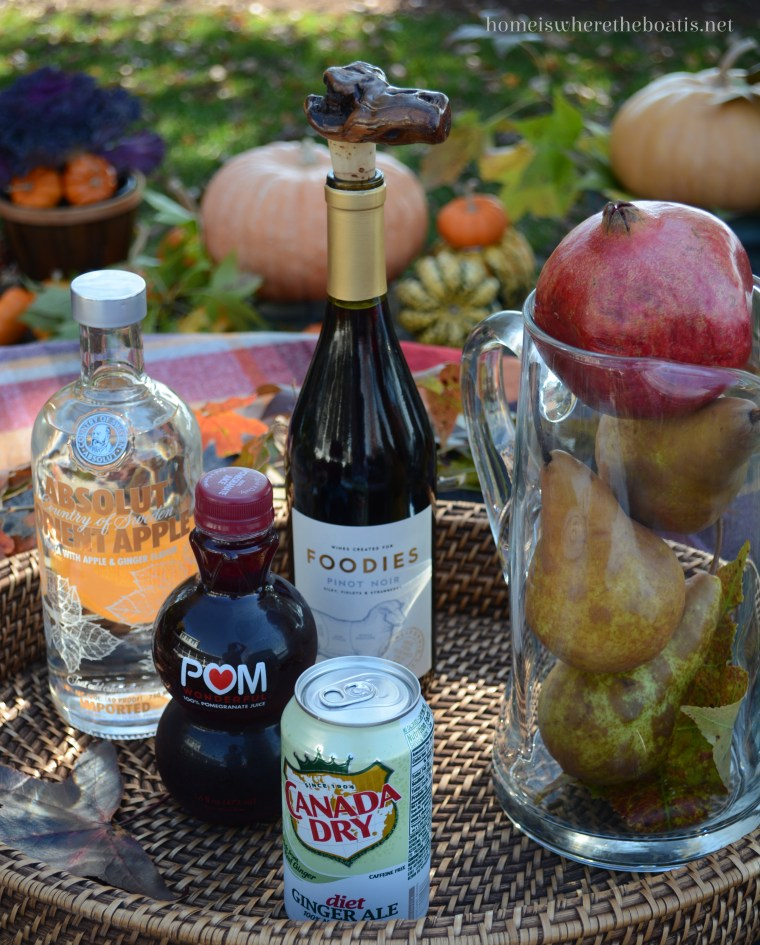Pomegranate and Pear Sangria | ©homeiswheretheboatis.net #recipes #fall #cocktail