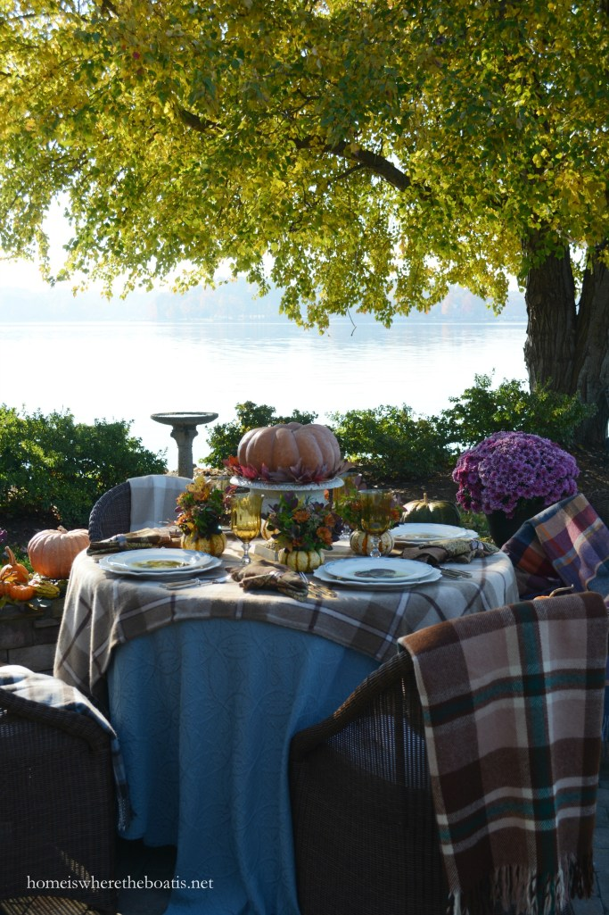Giving Thanks table by the lake with Warm Plaid Layers and Pumpkins | homeiswheretheboatis.net #Thanksgiving #fall #tablescapes #alfresco