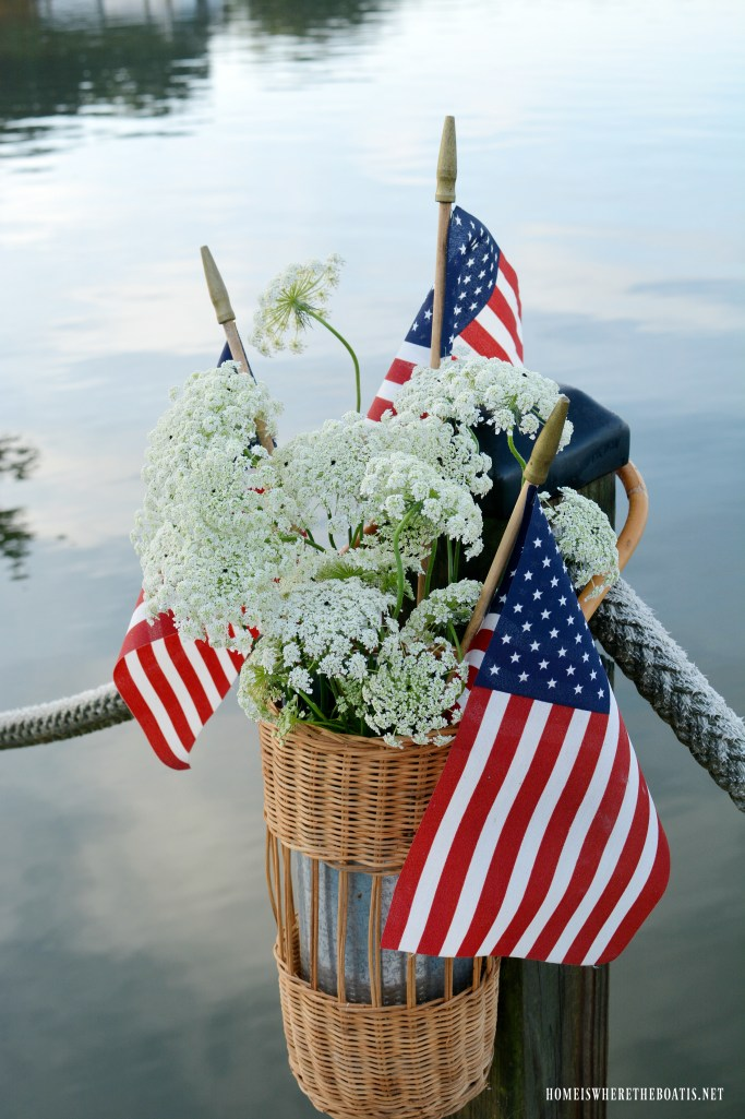 Dock basket with flags and Queen Anne Lace | ©homeiswheretheboatis.net #flag #memorialday #lake