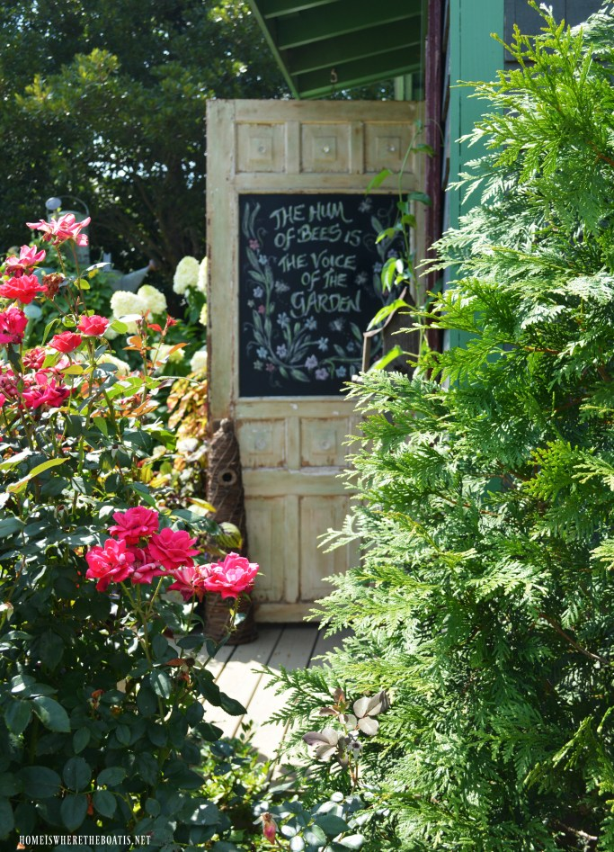 The Hum of Bees is the Voice of the Garden chalkboard door Potting Shed | ©homeiswheretheboatis.net #garden #flowers #bees #earthday