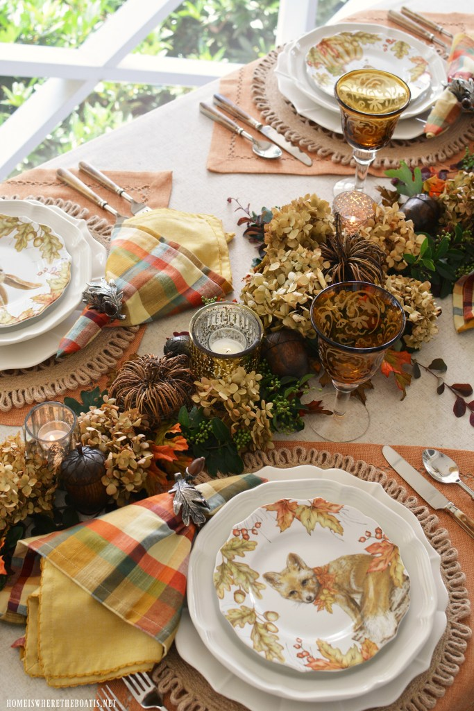 Fall table with woodland friends salad plates and natural DIY table runner | ©homeiswheretheboatis.net #fall #tablescapes
