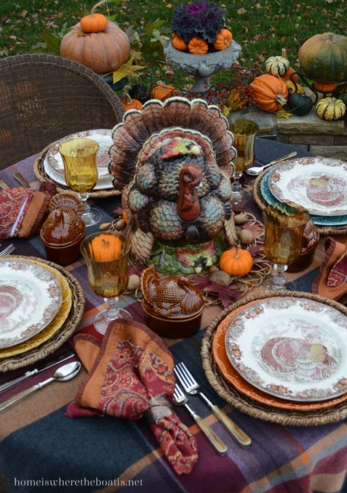 Autumn Monarch by Johnson Brothers and shades of purple, plum and pumpkin in a plaid fringed throw provide a warm and colorful foundation for Thanksgiving table | homeiswheretheboatis.net