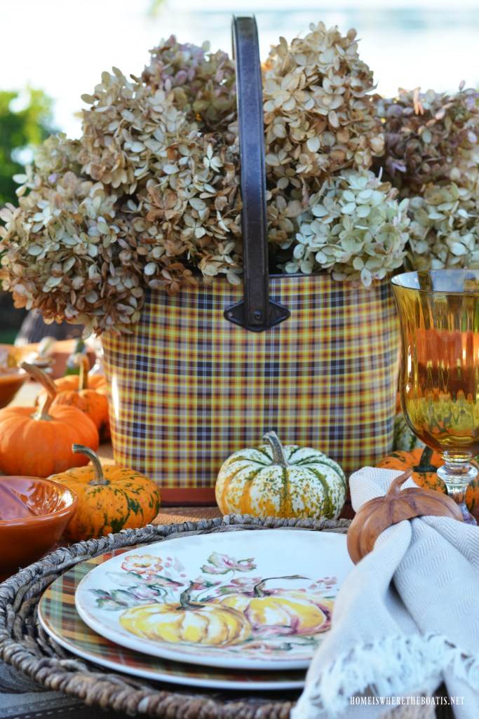Pumpkins and Plaid Alfresco Fall Table by the lake | ©homeiswheretheboatis.net #fall #tablescapes #pumpkins #plaid