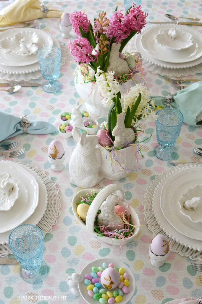 Easter table with pastels, eggs and bunnies | ©homeiswheretheboatis.net #Easter #tablesetting #tablescape #bunny