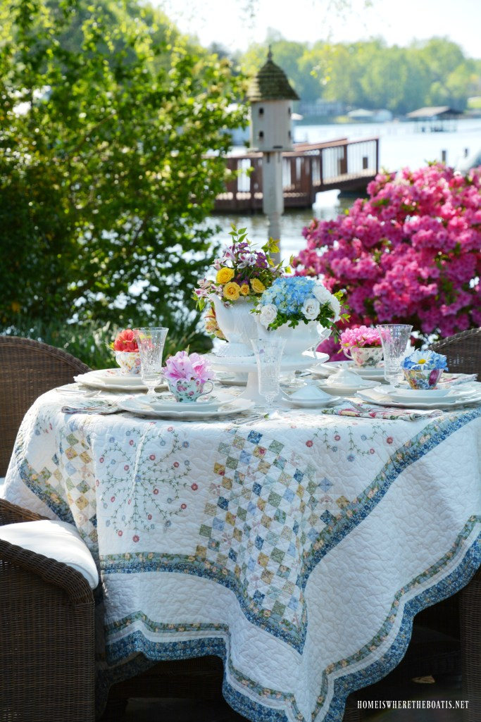 Fill teapots and teacups with flowers for Mother's Day or Garden Tea Party | ©homeiswheretheboatis.net #tablescape #garden #alfresco #teapot #MothersDay #teatime #teaparty