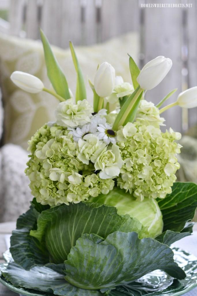 DIY Spring Green Cabbage Vase Floral Arrangement for St. Patrick's Day | ©homeiswheretheboatis.net #stpatricksday #flowerarrangement #cabbage #spring