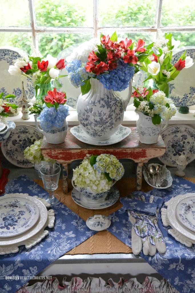 Blue transferware table vignette with flowers | ©homeiswheretheboatis.net #transferware #blueandwhite #redwhiteandblue #flowers #tablescapes