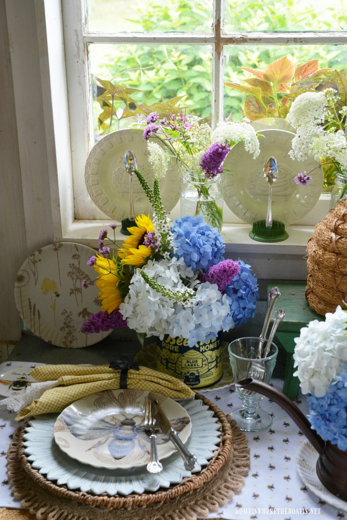 Bee table and vignette in Potting Shed for National Pollinator Week | ©homeiswheretheboatis.net #bees #tablescapes
