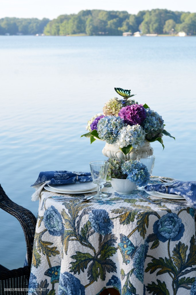 Lakeside table with hydrangeas and butterlfies | ©homeiswheretheboatis.net #flowers #hydrangeas #tablescape #lake