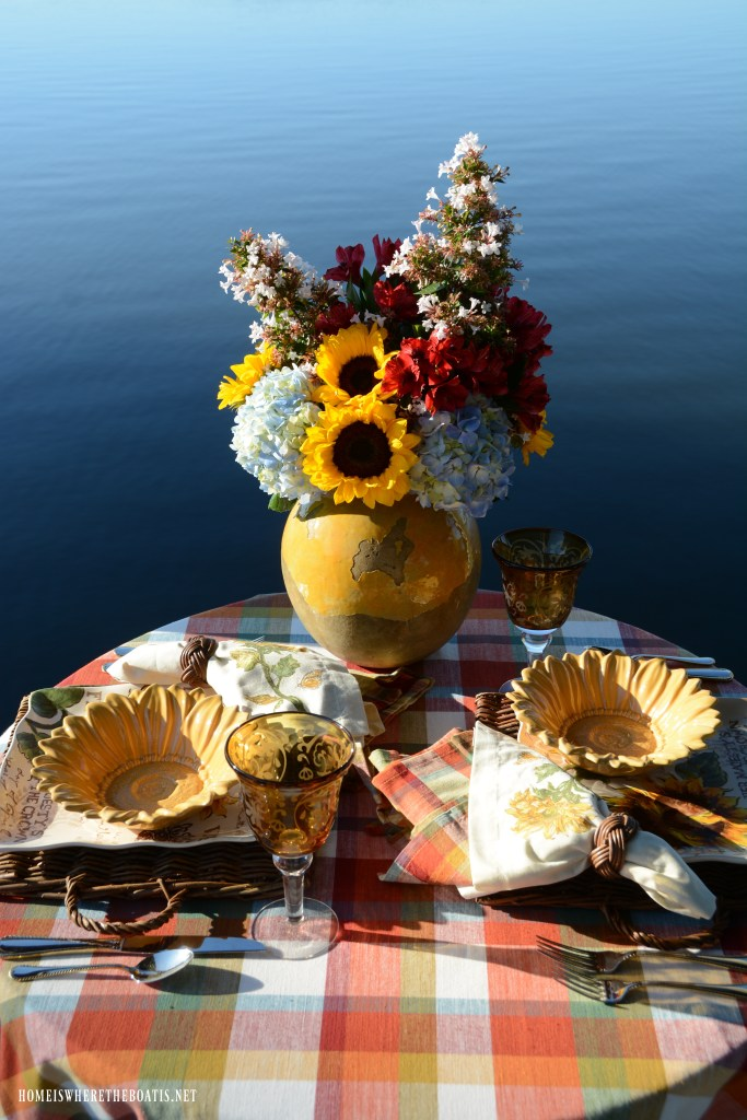 Lakeside table with sunflowers | ©homeiswheretheboatis.net #sunflowers #lake #summer #alfresco