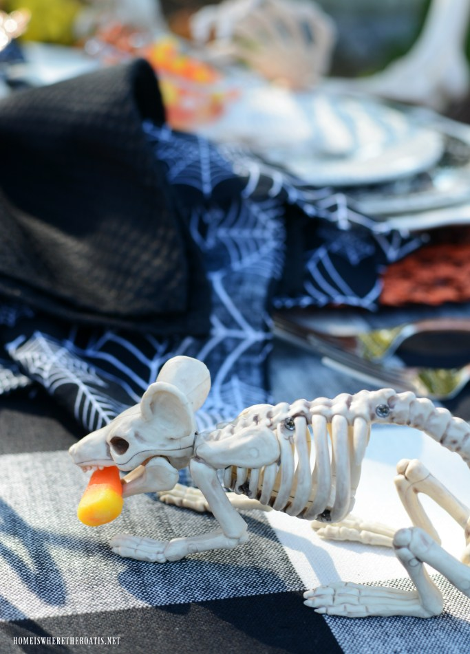 Skeleton mouse with candy corn for Halloween | ©homeiswheretheboatis.net #skeleton #halloween #tablescapes