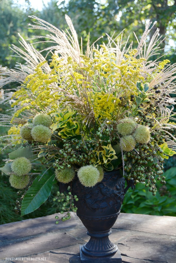 Fall arrangement with foliage, berries, pods and grasses | ©homeiswheretheboatis.net #fall #arrangement