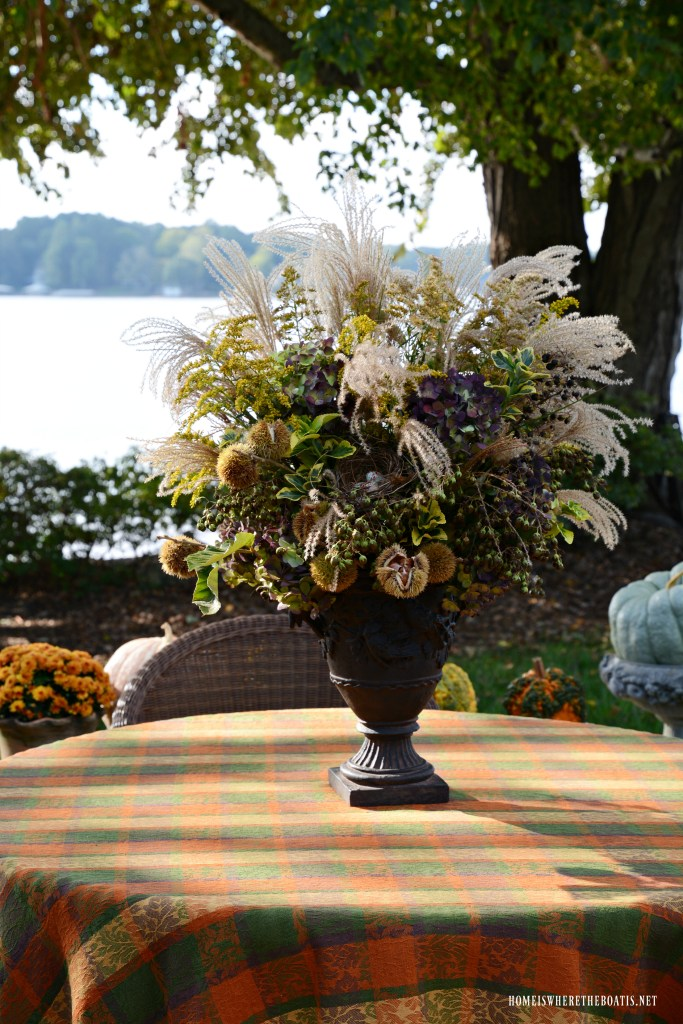 Fall Foliage Arrangement with bird nest | ©homeiswheretheboatis.net #fall #alfresco #tablescape #lake