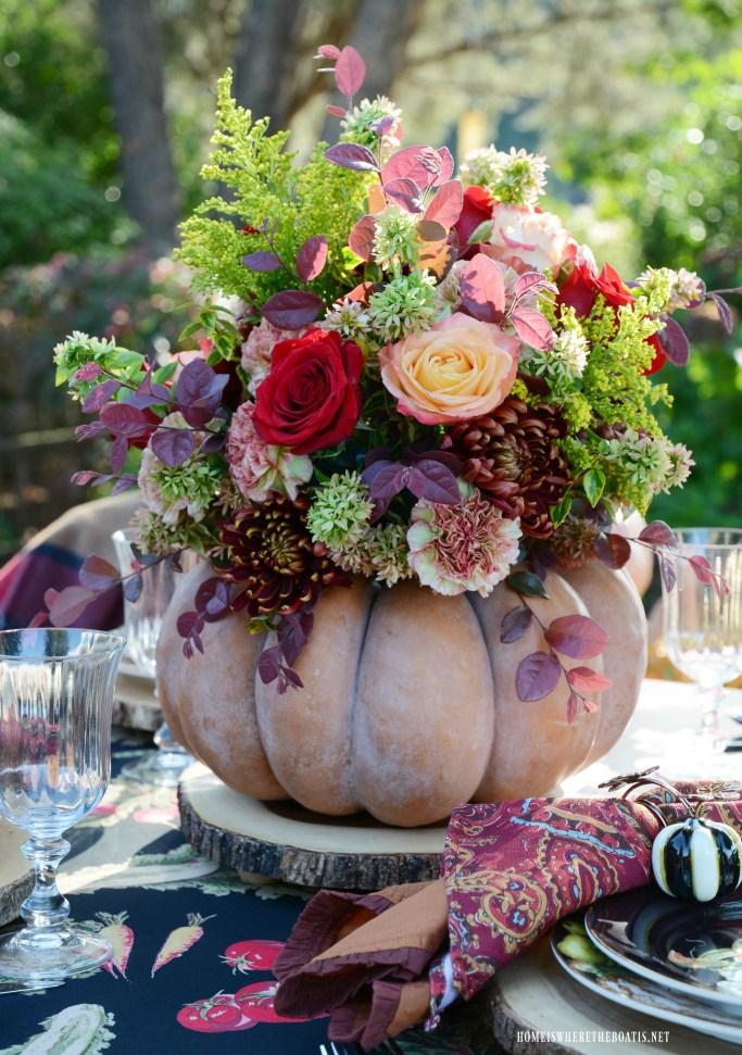 DIY Blooming Pumpkin the EASY Way, no cutting required! | ©homeiswheretheboatis.net #pumpkinvase #flowers #fall #centerpiece #pumpkin