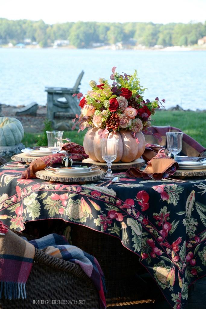 Autumn table with pumpkin centerpiece | ©homeiswheretheboatis.net #fall #tablescapes #alfresco #lake #pumpkin #centerpiece