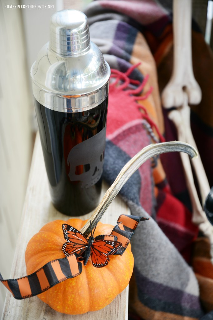 Skull Cocktail Shaker and Skeletons on the Porch | ©homeiswheretheboatis.net #Halloween #skeleton #porch #humerus